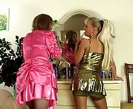 Horny sissy in pink capris going for butt play with a strap-on armed chick